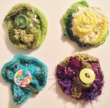 4 knitted broches